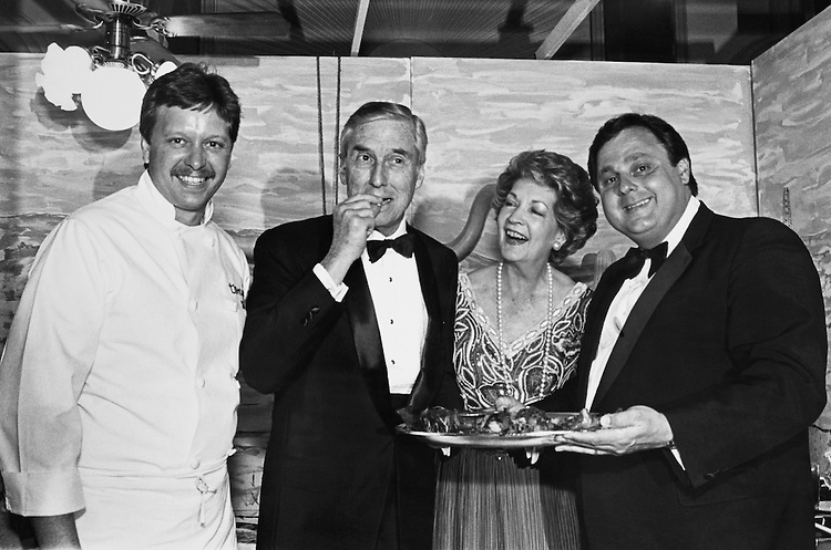 Chef Mark Cot, Sen. Lloyd Bentsen, D-Tex., Beryl Ann Longino, and Tony Vallone eating lobster stuffed squash blossoms  at the March of Dimes Gourmet Gala on June 5, 1988. (Photo by Andrea Mohin/CQ Roll Call)