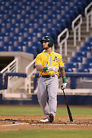 Rangel Ravelo of the AZL Athletics throws bats during a game against the AZL Brewers at Maryvale Baseball Park on June 30, 2015 in Phoenix, Arizona. Brewers defeated Athletics, 4-2. (Larry Goren/Four Seam Images)