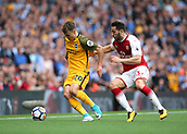 1st October 2017, Emirates Stadium, London, England; EPL Premier League Football, Arsenal versus Brighton; Solly March of Brighton feels pressure from Calum Chambers of Arsenal