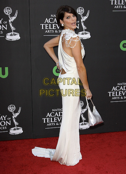 LESLI KAY.36th Annual Daytime Emmy Awards held At The Orpheum Theatre, Los Angeles, California, USA..August 30th, 2009.emmys full length white dress looking over shoulder long maxi beaded silver bag .CAP/ADM/KB.©Kevan Brooks/AdMedia/Capital Pictures.