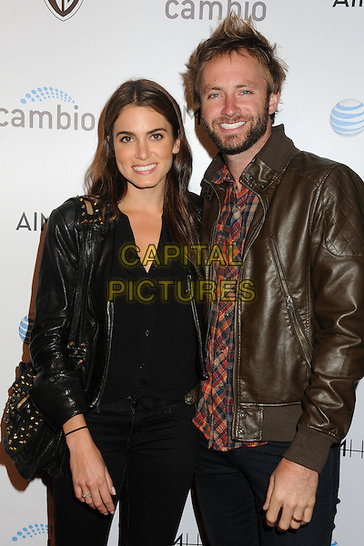 "Nikki Reed & Paul McDonald.""Aim High"" Los Angeles Premiere held at Trousdale, West Hollywood, California, USA..October 18th, 2011.half length black jeans denim top jacket bag purse boots leather brown couple married husband wife beard facial hair.CAP/ADM/BP.©Byron Purvis/AdMedia/Capital Pictures."