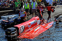 Mark Major (#17)   steps ashore after beaching his sinking boat.(Formula 1/F1/Champ class)