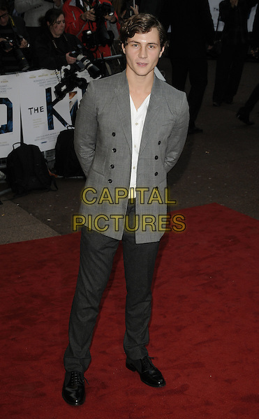 AUGUSTUS PREW .'The Kid'  UK premiere held at the Odeon West End, Leicester Square, London, England, 15th September 2010..full length jacket white t-shirt  grey gray trousers black shoes .CAP/CAN.©Can Nguyen/Capital Pictures.