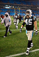 Carolina Panthers FB Brad Hoover (45) walks off the filed after loosing to the Arizona Cardinals during the NFC Divisional Playoff football game at Bank of America Stadium, in Charlotte, NC. Arizona defeated the Carolina Panthers 33-13.