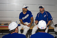 20 August 2007: Coach Joshua Ridgway (right), next to coach Sylvain Virey, talks to Team France prior to the Czech Republic 6-1 victory over France in the Good Luck Beijing International baseball tournament (olympic test event) at the Wukesong Baseball Field in Beijing, China.