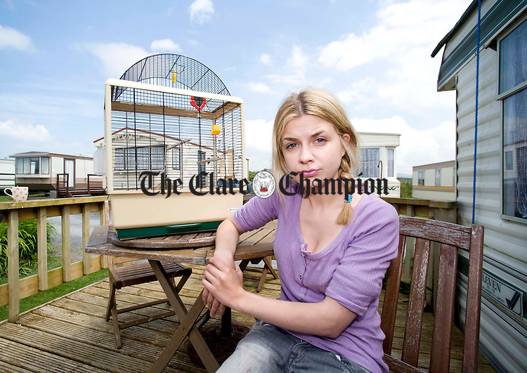 Molly Mulcahy with her empty birdcage at the caravan park in Spanish Point. Photograph by Declan Monaghan
