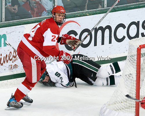 Jeff Petry (Michigan State - 2), John Mitchell (Wisconsin - 24) - The University of Wisconsin Badgers and Michigan State University Spartans played to a 4-4 tie in their College Hockey Showcase matchup on Saturday, November 24, 2007, at Munn Ice Arena in East Lansing, Michigan.