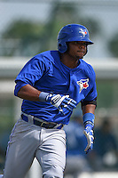 Toronto Blue Jays Juan Puello (5) during a minor league spring training game against the Pittsburgh Pirates on March 21, 2015 at Pirate City in Bradenton, Florida.  (Mike Janes/Four Seam Images)