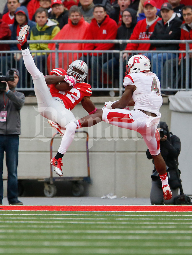 Ohio State Buckeyes cornerback Doran Grant (12) intercepts a pass near the end of the second quarter of an NCAA college football game between The Ohio State Buckeyes and the Rutgers Scarlet Knights at Ohio Stadium on Saturday, October 18, 2014.  (Columbus Dispatch photo by Fred Squillante)