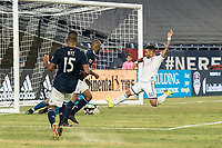 FOXBOROUGH, MA - JULY 27:  Dom Dwyer #14 and Matt Turner #30 go for the ball near the goal at Gillette Stadium on July 27, 2019 in Foxborough, Massachusetts.