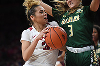 NWA Democrat-Gazette/J.T. WAMPLER Arkansas' Chelsea Dungee drives to the basket while University of Alabama at Birmingham's Angela Vendrell defends Sunday March 24, 2019 at Bud Walton Arena in Fayetteville during the second round of the Women's National Invitational Tournament. Arkansas won 100-52 and takes on TCU Thursday night at home.