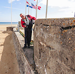 VMI Vincentian Heritage Tour: Normandy France side trip - Rick Niedziela, associate dean for instruction, DePaul University's College of Science and Health, tours the Juno Beach landing zone in Normandy, France.(DePaul University/Jamie Moncrief)