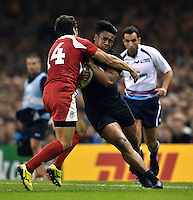 Julian Savea of New Zealand is tackled by Giorgi Aptsiauri of Georgia. Rugby World Cup Pool C match between New Zealand and Georgia on October 2, 2015 at the Millennium Stadium in Cardiff, Wales. Photo by: Patrick Khachfe / Onside Images