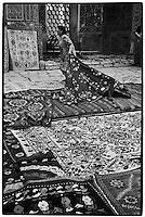 uzbekistan - Samarkand - A carpet seller inside the Registan