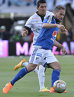 BOGOTA - COLOMBIA -26 -07-2015: Federico Insua (Der) jugador de Millonarios disputa el balón con Michael Ordoñez (Izq) jugador de Once Caldas durante partido por la fecha 3 de la Liga Águila II 2015 jugado en el estadio Nemesio Camacho El Campín de la ciudad de Bogotá./ Federico Insua (R) player of Millonarios fights for the ball with Michael Ordoñez (L) player of Once Caldas during the match for the third date of the Aguila League II 2015 played at Nemesio Camacho El Campin stadium in Bogotá city. Photo: VizzorImage / Gabriel Aponte / Staff.