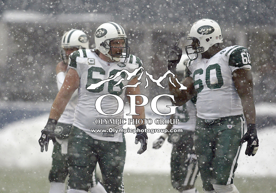 December 21, 2008:  NY Jets offensive lineman #66 Alan Faneca & #60 D'Brickshaw Ferguson talk over blocking schemes against the Seattle Seahawks at Quest Field in Seattle, WA.  Seattle won 13-3 over the NY Jets.