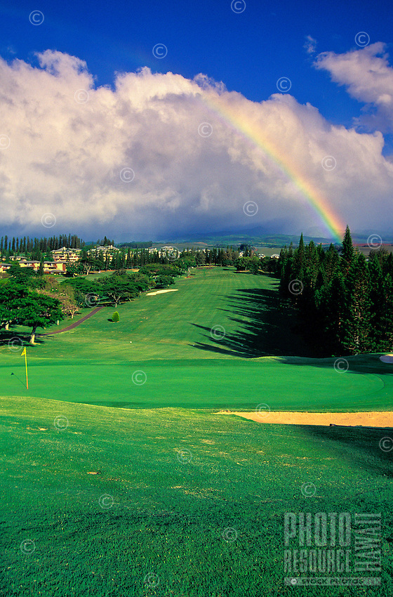 A rainbow over Kapalua Bay Golf Course, the first of three championship golf courses in Kapalua. Designed by Arnold Palmer and Francis Duane, it is a 6,600-yard par 72 course.