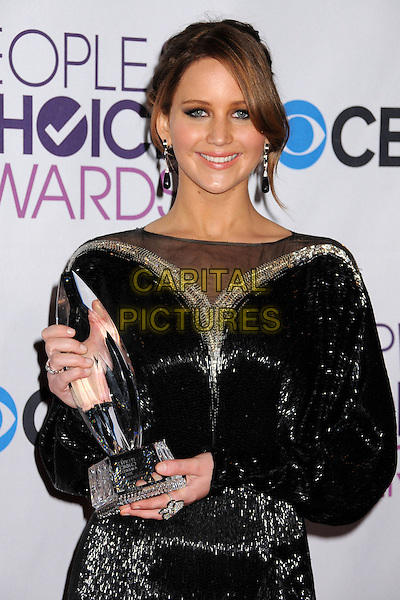 Jennifer Lawrence.People's Choice Awards 2013 - Press Room held at Nokia Theatre L.A. Live, Los Angeles, California, USA..January 9th, 2013.half length black gold sheer dress sparkly sequins sequined award trophy winner  .CAP/ADM/BP.©Byron Purvis/AdMedia/Capital Pictures.
