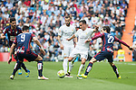 Real Madrid's  Lucas Vazquez and Sociedad Deportiva Eibar's Sergi Enrich and Jota Peleteiro during La Liga match. April 09, 2016. (ALTERPHOTOS/Borja B.Hojas)