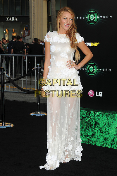 """Blake Lively. """"Green Lantern"""" Los Angeles Premiere held at Grauman's Chinese Theatre, Hollywood, California, USA, .15th June 2011..full length dress long maxi sheer see thru through hair side plait messy braid fishtail flower flowers white chanel couture applique  hand on hip gold bracelets bangles .CAP/ADM/BP.©Byron Purvis/AdMedia/Capital Pictures."""