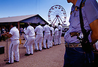 An inmate croons into the microphone as the Traveling Choir from Texas' Ramsey III prison puts on a pop-rock-gospel show at the Brazoria County Fair.
