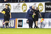 The Asssistant Referee (right) receives treatment and cannot continue during the Sky Bet League 2 match between Luton Town and Wycombe Wanderers at Kenilworth Road, Luton, England on 26 December 2015. Photo by David Horn.