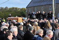 Photographers  capture Paidi O'Se's remains as they are carried  to the church from his homel in Ventry, County Kerry. Photo: Don MacMonagle