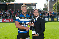 Pol Roger Man of the Match Rhys Priestland is awarded his bottle of champagne by team-mate Darren Allinson.  Aviva Premiership match, between Bath Rugby and Saracens on September 9, 2017 at the Recreation Ground in Bath, England. Photo by: Patrick Khachfe / Onside Images