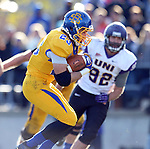 BROOKINGS, SD - OCTOBER 26:  Brandon Hubert #23 from South Dakota State University eludes the defense of Collin Albrecht #92 from Northern Iowa in the third quarter of their game Saturday afternoon at Coughlin Alumni Stadium in Brookings. (Photo by Dave Eggen/Inertia)