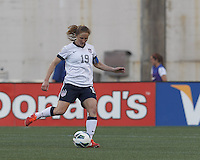 USWNT defender Rachel Buehler (19) passes the ball.  In an international friendly, the U.S. Women's National Team (USWNT) (white/blue) defeated Korea Republic (South Korea) (red/blue), 4-1, at Gillette Stadium on June 15, 2013.