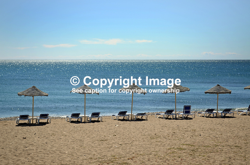 Mediterranean Sea, beach, recliners, sunbeds, beach umbrella, parasols, San Pedro de Alcantara, Marbella, Spain, 201403263095<br />
