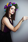 young brunette woman in a flower crown looking away