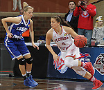 SIOUX FALLS MARCH 22:  Flo Ward #4 of Florida Southern drives toward Lubbock Christian defender Nicole Hampton #2 during their quarterfinal game at the NCAA Women's Division II Elite 8 Tournament at the Sanford Pentagon in Sioux Falls, S.D. (Photo by Dick Carlson/Inertia)