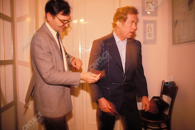 Vaclav Havel at home, being fitted for his presidential suit before the inauguration. Prague, Czechoslovakia, December 1989.