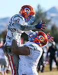 Bishop Gorman's Biaggio Ali Walsh (7) and Julio Garcia II (74) celebrate a touchdown against Reed in an NIAA Division I playoff game at Reed High School in Sparks, Nev., on Saturday, Nov. 28, 2015. Bishop Gorman won 41-13. (Cathleen Allison/Las Vegas Review-Journal)