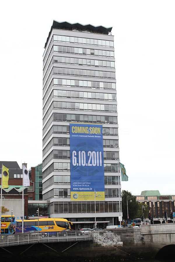 """NO REPRO FEE. 22/9/2011. Author, journalist and health rights campaigner Orla Tinsley joins rights campaigners to launch the """"Your Rights Right Now"""" campaign's flagship 25 metre-high banner, which was unfurled on Dublin's Liberty Hall. The appearance of the banner, which will dominate the Liffey skyline for the next fortnight, marks the final countdown to Ireland's first ever full hearing on its human rights record under the United Nations 'Universal Periodic Review' (UPR) in Geneva on 6th October 2011. For further information, see the note below, and/or contact: Walter Jayawardene walter.jayawardene@iccl.ie. Tel. + 353 1 799 4503Mob: +353 87 9981574. Picture James Horan/Collins Photos"""
