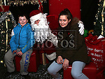Kyle Murray with Sophia Thompson Murray visiting Santa at the Laurence Centre.
