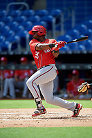 Washington Nationals Jamori Blash (30) follows through on a swing during a Florida Instructional League game against the Miami Marlins on September 26, 2018 at the Marlins Park in Miami, Florida.  (Mike Janes/Four Seam Images)