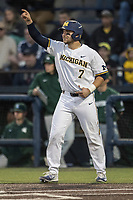 Michigan Wolverines catcher Harrison Wenson (7) celebrates scoring against the Michigan State Spartans during the NCAA baseball game on April 18, 2017 at Ray Fisher Stadium in Ann Arbor, Michigan. Michigan defeated Michigan State 12-4. (Andrew Woolley/Four Seam Images)