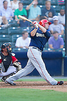 Tim Pahuta #44 of the Harrisburg Senators follows through on his swing against the Richmond Flying Squirrels in game one of a double-header at The Diamond on July 22, 2011 in Richmond, Virginia.  The Squirrels defeated the Senators 3-1.   (Brian Westerholt / Four Seam Images)