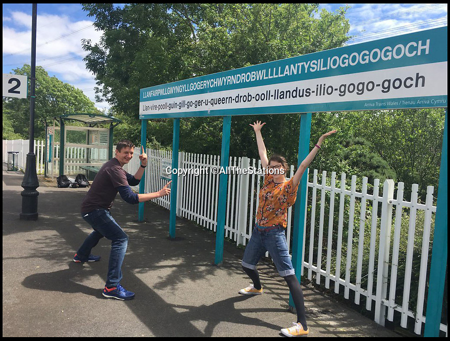 BNPS.co.uk (01202 558833)<br /> Pic: AllTheStations/BNPS<br /> <br /> Vicki and Geoff at the longest station name in Wales...<br /> <br /> An intrepid couple have completed an epic train journey that saw them visit every railway station in Britain in three months.<br /> <br /> Geoff Marshall, 44, and Vicki Pipe, 34, have been to all 2,563 of the mainland train stations in the UK, travelling from Land's End in Cornwall to John O'Groats in Scotland.<br /> <br /> The couple began their railway adventure in Penzance, Cornwall and worked their way up the country, averaging 30 stations per day.<br /> <br /> They finished on Saturday in Wick, one of Scotland's most Northern towns, setting foot on the platform at just after 6pm.