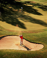 Aerial view of a golfer in a sandtrap on the 10th hole of the Widgi Creek Course. Bend, Oregon.