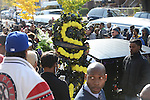 A man carries a wreath from the Scott Joplin Elementary School where Tyshawn Lee, 9, who was shot multiple times while playing basketball in an alley on November 2, 2015, was a student from St. Sabina's following Lee's funeral in Chicago, Illinois on November 10, 2015. Police allege the killing was a retaliatory gang hit which would mark a new turn in Chicago's gang wars.