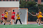 Los Angeles, CA 02/28/14 - Liz Shaeffer (USC #11), Jamie Romano (Marist #13) and unidentified USC player(s) in action during the Marist Red Foxes vs University of Southern California Trojans NCAA Women's lacrosse game at Loker Track Stadium on the USC Campus.  Marist defeated USC 12-10.