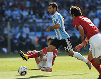 Midfielder Javier Mascherano splits a seam in the South Korean defense. Argentina defeated South Korea, 4-1, in both teams' second match of play in Group B of the 2010 FIFA World Cup. The match was played at Soccer City in Johannesburg, South Africa June 17th.