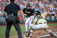Louisville Cardinals pinch runner Trey Leonard (14) runs to home plate against the Vanderbilt Commodores in the NCAA College World Series on June 21, 2019 at TD Ameritrade Park in Omaha, Nebraska. Leonard was tagged out by catcher Ty Duvall (20) and Vanderbilt defeated Louisville 3-2 to head to the CWS Finals. (Andrew Woolley/Four Seam Images)