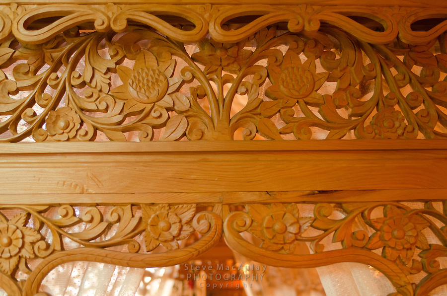Interior detail views of carved woodwork in master bedroom of traditional Kashmiri houseboat, Dal Lake, Srinagar, Kashmir, India.