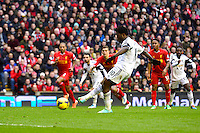 Sunday, 23 February 2014<br /> Pictured: Swansea City's Wilfried Bony scores the third goal from the penalty spot<br /> Re: Barclay's Premier League, Liverpool FC v Swansea City FC v at Anfield Stadium, Liverpool Merseyside, UK.