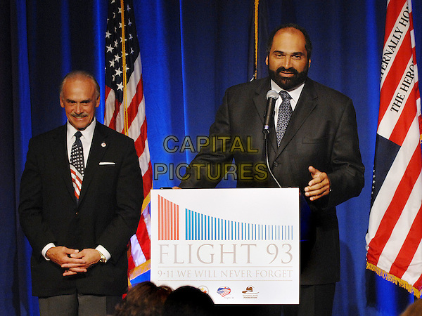 "FRANCO HARRIS.speaks at the ""9/11 We Will Never Forget"" Dinner held at Heinz Field East Club. A Night to Remember The Heroes of Flight 93 that went down on September 11, 2001 in Shanksville, PA, USA, 11th September 2009..9 11 nine eleven half length memorial politics speaking podium microphone beard facial hair beard hands grey gray black suit.CAP/ADM/JLN.©Jason L Nelson/Admedia/Capital Pictures"