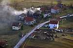 (Tuzla, Bosnia, 02/06/02) Several homes are seen from the air as members of the Massachusetts Army National Guard maintain order in the aftermath of ethnic cleansing and prevent a resumption of violence that ravaged the former Yugoslav state by provide security for displaced residents returning to rebuild their shattered homes in Northern Bosnia on Wednesday, February 06, 2002. Staff photo by Christopher Evans